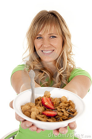 Woman holding out cereal smile