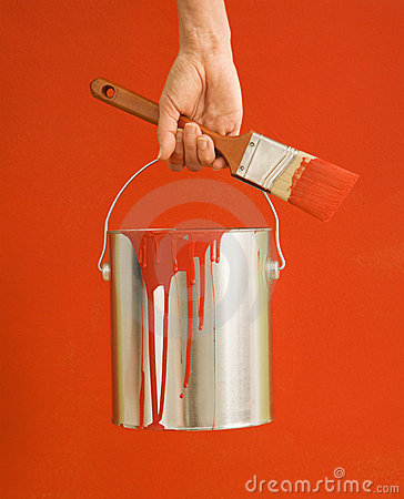 Woman holding paint can.
