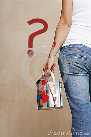 Woman Holding Paint Can With Painted Question Mark On Wall