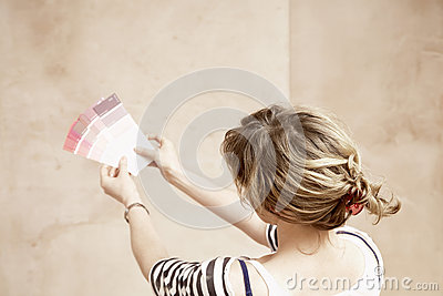 Woman Holding Paint Color Swatches