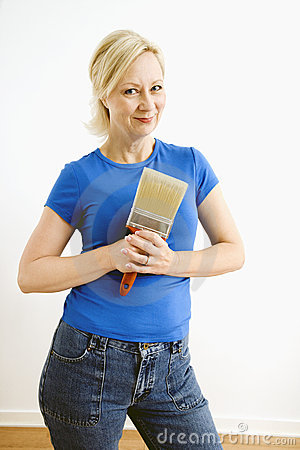 Woman holding paintbrush.