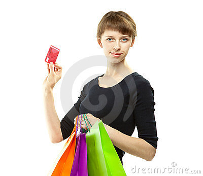 Woman holding paper bags and credit card