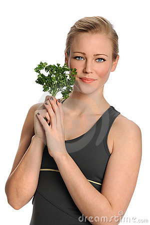 Free Woman Holding Parsley Royalty Free Stock Images - 23061349
