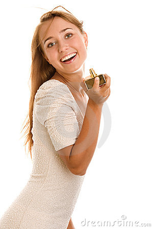 Woman holding perfume bottle