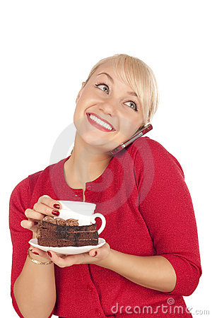 Woman holding a phone and cap of coffee