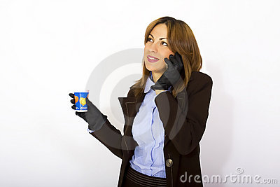 Woman holding phone and coffee