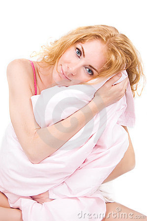Woman holding pillow