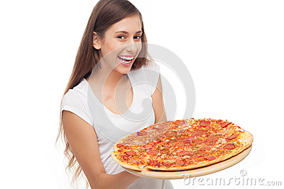 Woman holding pizza