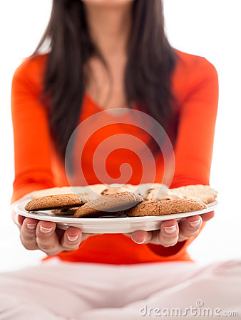 Woman holding plate of biscuits