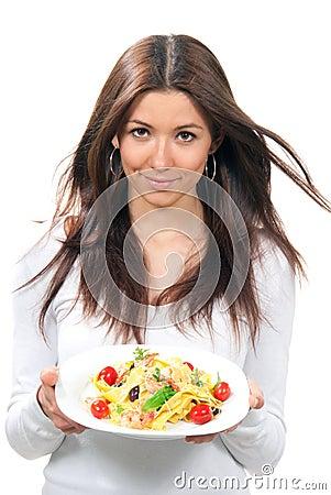 Woman holding plate with macaroni, spaghetti pasta