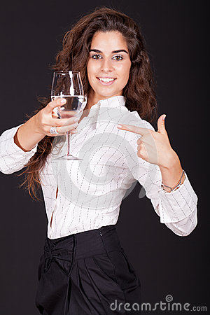 Woman holding and point to a glass of water