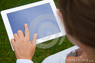 Woman holding and pointing at  tablet PC