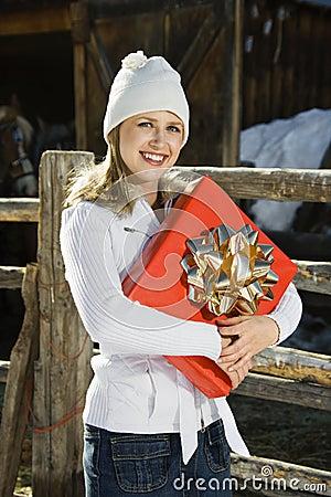 Woman holding present.