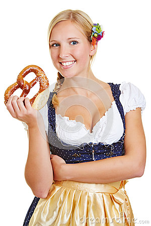 Woman holding pretzel in dirndl