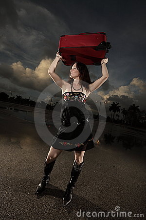 Woman holding a red briefcase