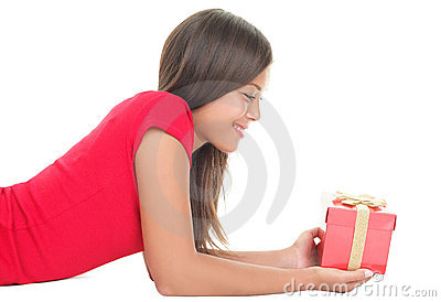 Woman holding red christmas gift isolated on white