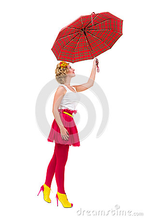 Woman holding a red umbrella