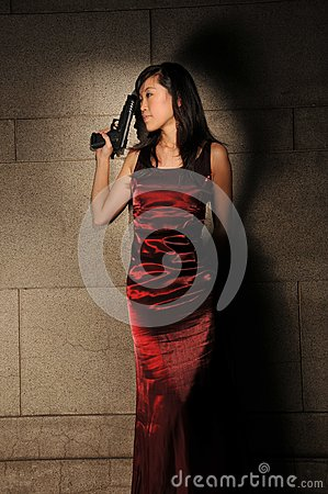 Woman Holding A Revolver In An Underground Tunnel