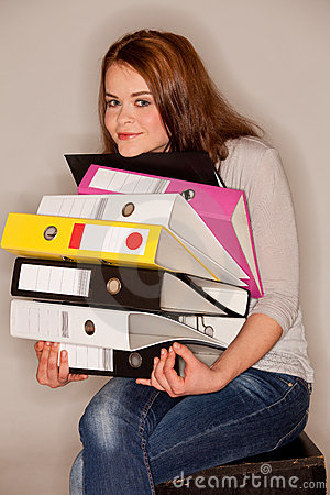 Woman holding ring binders