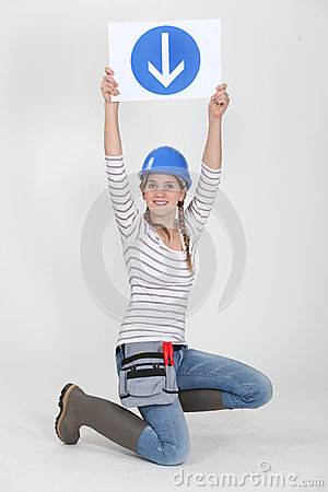 Woman holding road sign