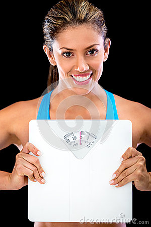 Woman holding a scale