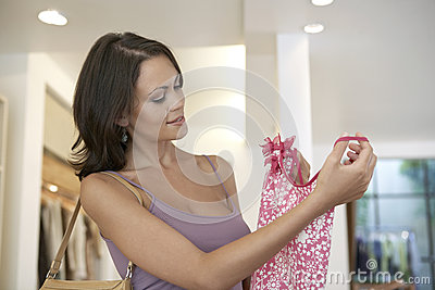Woman Holding Shirt