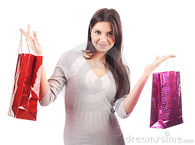 Woman holding shopping bag. Isolated