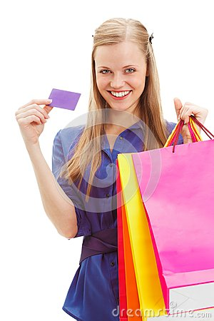 Woman holding shopping bags and card