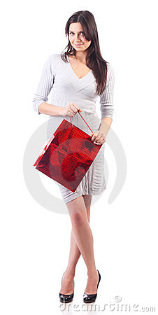 Woman holding shopping red bag. Isolated