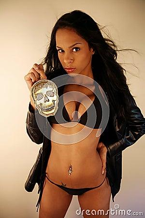Woman holding skull medallion
