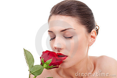 Woman holding and smelling red rose