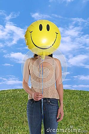 Woman Holding Smiley Balloon
