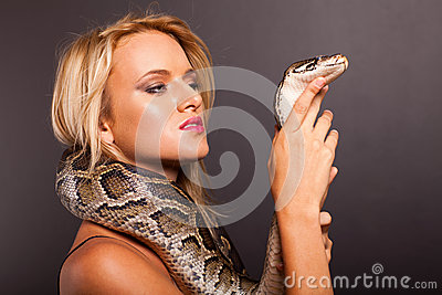 Woman holding snake