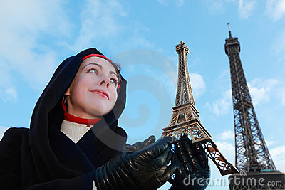 Woman holding souvenir, view of Eiffel Tower