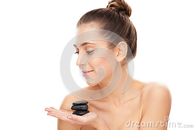 Woman holding spa stones