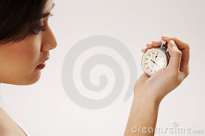 Woman holding stop watch