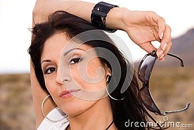 Woman holding sunglasses.