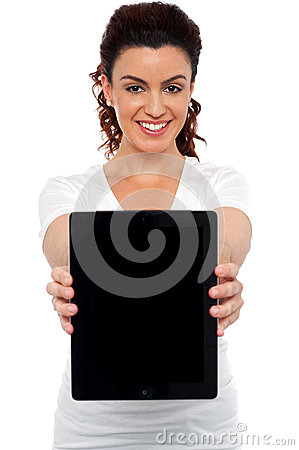 Woman holding tablet device, showing it to camera