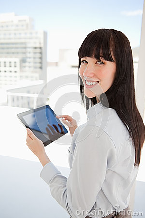Woman holding a tablet pc in her hands