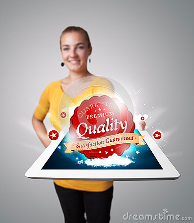 Woman holding tablet with red quality label
