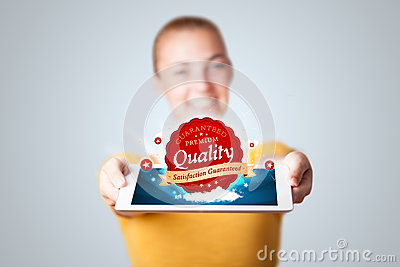 Woman holding tablet with red quality label in clouds