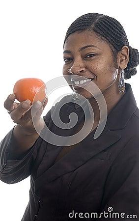 Woman holding tangerine