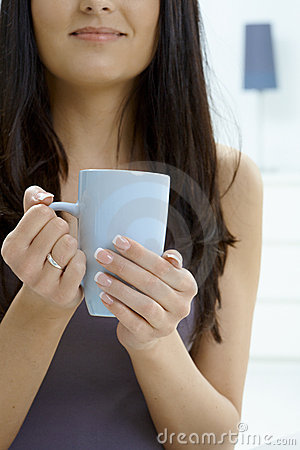 Woman Holding Tea Cup Royalty Free Stock Photo - Image: 9730375