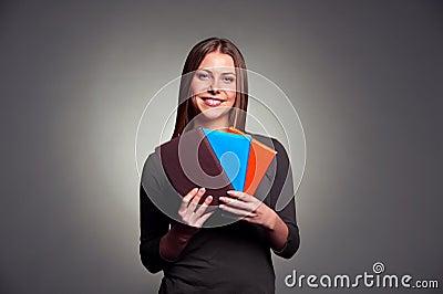 Woman holding three books