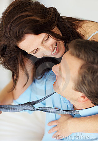 Woman holding tie and looking at partner s face