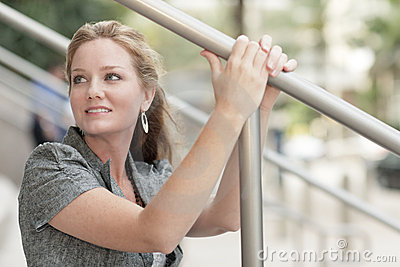 Woman holding on to a handrail