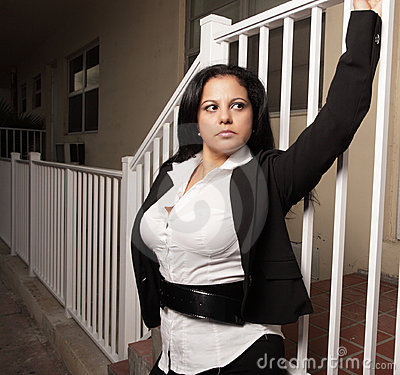Woman holding on to a rail