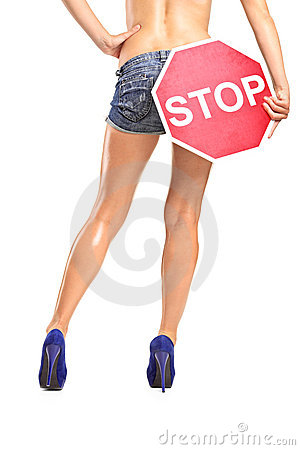 Woman holding a traffic sign stop over her buttock