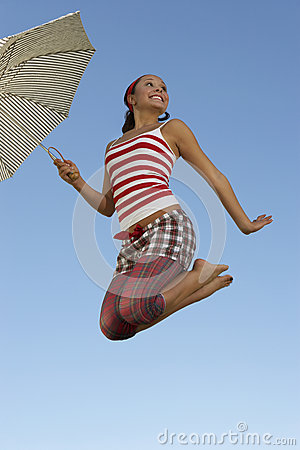 Woman Holding Umbrella In Midair