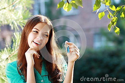 Woman holding up a set of keys